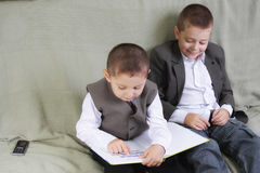 Positive brothers reading book Royalty Free Stock Photography