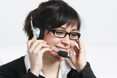Positive brunette businesswoman with headset Royalty Free Stock Photo