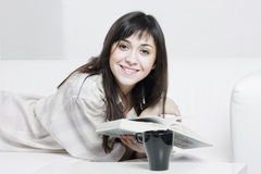 Positive brunette in casual reading Royalty Free Stock Photo