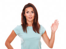 Positive brunette female with greeting hand Stock Photos