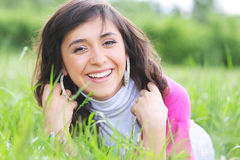Positive brunette in grass Stock Photos
