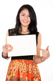 Positive brunette holding at white empty blank Royalty Free Stock Photos