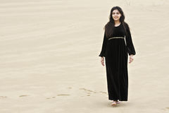 Positive brunette in sands Stock Photo