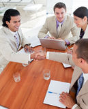 Positive Business associates closing a deal. In a meeting Royalty Free Stock Image