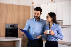 Positive business colleagues standing in the kitchen royalty free stock photos