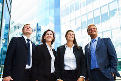 Positive business group looking up with dreaming expressio Stock Photography