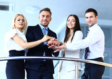 Positive business group standing on stairs of modern building Royalty Free Stock Photo