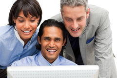 Positive business group working at a computer Royalty Free Stock Image