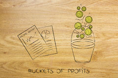 Positive business income report next to bucket with coins droppi Royalty Free Stock Images