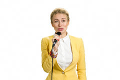 Positive business lady with microphone. Royalty Free Stock Photography