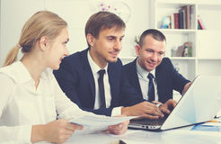 Positive business male sitting with coworkers royalty free stock image