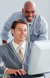 Positive business partners working at a computer Royalty Free Stock Image