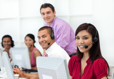 Positive business people with headset on working. In the office Royalty Free Stock Photos