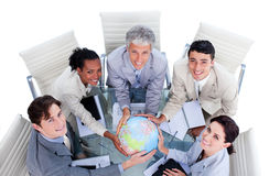 Positive business people holding a globe Royalty Free Stock Photography