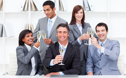Positive business people toasting with Champagne Stock Photography