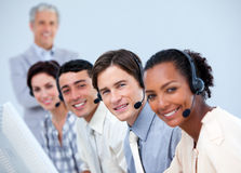 Positive business people working in a call center Royalty Free Stock Photo