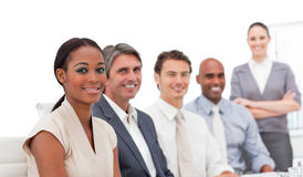 Positive business team smiling at the camera Stock Image