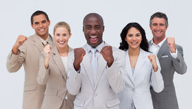 Positive business team standing and smiling Royalty Free Stock Photos