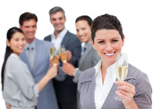Positive business team toasting with Champagne Royalty Free Stock Images