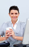 Positive business woman drinking coffee Royalty Free Stock Photography