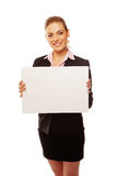 Positive business woman holding white board Royalty Free Stock Photos