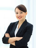 Positive business woman smiling over white Stock Photo
