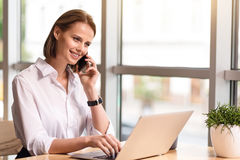 Positive business woman talking on cell phone Stock Image
