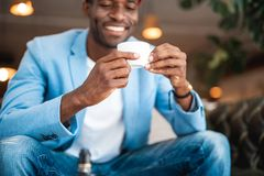 Outgoing male relaxing with cup of coffee Stock Photography