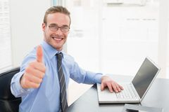Positive businessman with glasses and thumb up Stock Photos