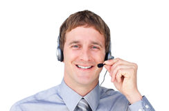Positive businessman with headset on Stock Photo