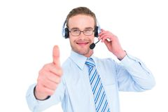 Positive businessman with headset end thumb up Stock Images