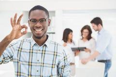 Positive businessman making okay gesture Stock Photos