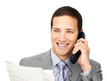Positive businessman on phone holding a newspaper Royalty Free Stock Photography