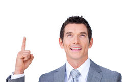 Positive businessman pointing upward Stock Images
