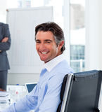 Positive businessman at a presentation Stock Photo