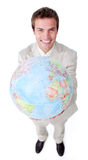 Positive businessman showing a terrestrial globe. Isolated on a white background stock photos