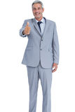Positive businessman showing thumb up Stock Images