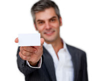Positive businessman showing a white card Royalty Free Stock Image