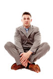 Positive businessman sitting cross legged Stock Photography