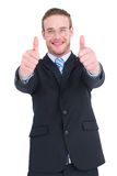 Positive businessman smiling with thumbs up Royalty Free Stock Images