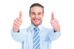 Positive businessman smiling with thumbs up Royalty Free Stock Photography