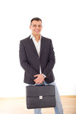Positive businessman in suit with briefcase Royalty Free Stock Photography