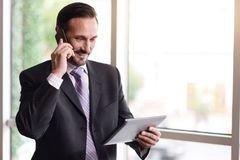 Positive businessman talking on cell phone Royalty Free Stock Photos