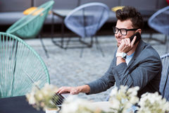Positive businessman talking on cell phone Royalty Free Stock Photography