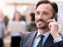 Positive businessman talking on cell phone Royalty Free Stock Images