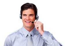 Positive Businessman talking on headset. Against a white background Royalty Free Stock Image