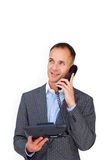 Positive businessman talking on a phone Royalty Free Stock Image