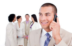 Positive businessman talking on phone Stock Image