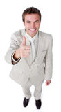 Positive businessman with thumb up Royalty Free Stock Images