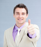 Positive businessman with a thumb up Royalty Free Stock Photos